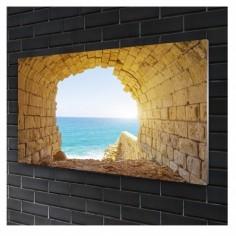Tablou sticla Arc vechi de piatră cu vedere la marea albastră 90x60 cm Decoglass